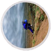 A Woman Rappelling Down Next To Deer Round Beach Towel