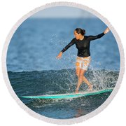 A Woman Rides A Wave On A Longboard Round Beach Towel