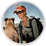 A Woman  Talks To Her Dog While Taking Round Beach Towel