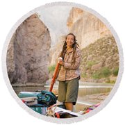 A Woman Unloads Gear From Her Canoe Round Beach Towel