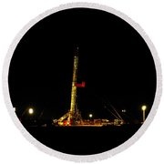 A Workover Rig At Night Round Beach Towel