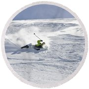 A Young Man Falls While Skiing Round Beach Towel