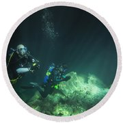 A Young Married Couple Scuba Diving Round Beach Towel by Michael Wood