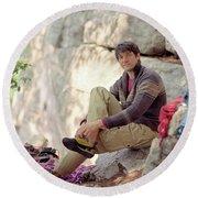 A Young Rock Climber Puts On A Climbing Round Beach Towel