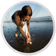A Young Woman Collects Seashells Round Beach Towel