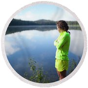 A Young Woman Looks Out Over Unna Lake Round Beach Towel