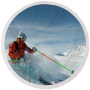 A Young Woman Skis The Backcountry Round Beach Towel
