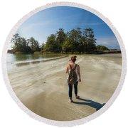 A Young Woman Walks Towards Frank Round Beach Towel