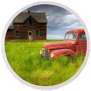 Abandoned Homestead House And Red Round Beach Towel