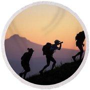 Adventure Racing Team Hiking At Sunset Round Beach Towel