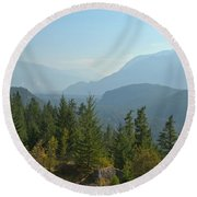 Afternoon Smoke At The Tantalus Mountains Round Beach Towel
