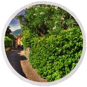 Alley With Green Plants Round Beach Towel