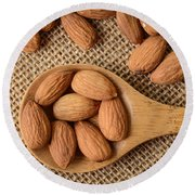 Almonds On A Spoon With Brown Background Round Beach Towel