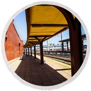 Alone At The Station Round Beach Towel