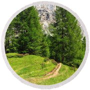 alpine path in Contrin Valley Round Beach Towel