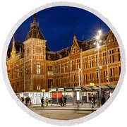 Amsterdam Central Station And Tram Stop At Night Round Beach Towel