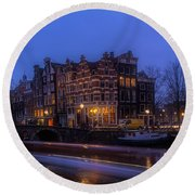 Amsterdam Corner Cafe With Light Trails Round Beach Towel
