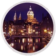Amsterdam In The Netherlands By Night Round Beach Towel