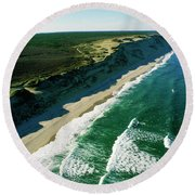 An Aerial View Of Waves Hitting Round Beach Towel