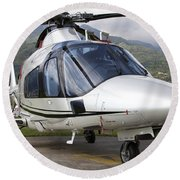 An Agustawestland A109 Power Elite Round Beach Towel