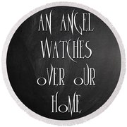 An Angel Watches Over Our Home Round Beach Towel