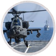 An Army Ah-64d Apache Helicopter Takes Round Beach Towel