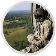 An Army Crew Chief Looks Out The Door Round Beach Towel