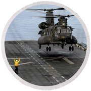 An Army Mh-47g Chinook Conducts Deck Round Beach Towel