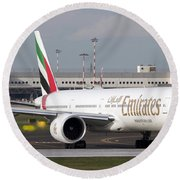 An Emirates Boeing 777 At Milano Round Beach Towel