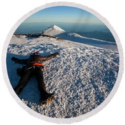 An Exhausted Climber Lies On The Summit Round Beach Towel