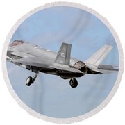 An F-35a Taking Off From Eglin Air Round Beach Towel