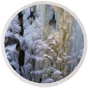 An Ice Climber Ascends A Frozen Round Beach Towel
