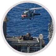 An Mh-60s Sea Hawk Delivers Supplies Round Beach Towel