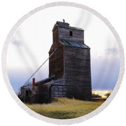 An Old Grain Elevator Off Highway Two In Montana Round Beach Towel