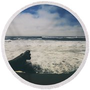 And It Goes On Round Beach Towel