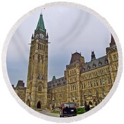 Another View Of Parliament Building In Ottawa-on Round Beach Towel