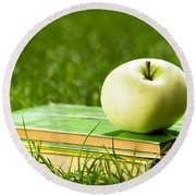 Apple On Pile Of Books On Grass Round Beach Towel