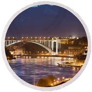 Arrabida Bridge At Night In Porto And Gaia Round Beach Towel