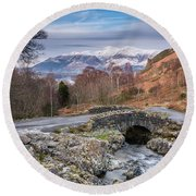 Ashness Bridge And Snow Capped Skiddaw Round Beach Towel