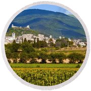 Assisi From The Sunflower Fields Round Beach Towel