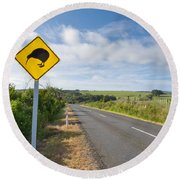 Attention Kiwi Crossing Roadsign At Nz Rural Road Round Beach Towel