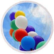 Balloons Against A Cloudy Sky Round Beach Towel