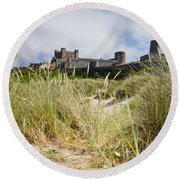 Bamburgh Castle From The Dunes Round Beach Towel