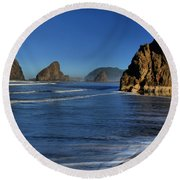 Bandon Sea Stacks In The Surf Round Beach Towel by Adam Jewell