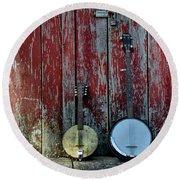 Banjos Against A Barn Door Round Beach Towel