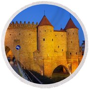 Barbican At Night In The Old Town Of Warsaw Round Beach Towel