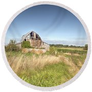 Barn In A Field With Hay Bales Round Beach Towel