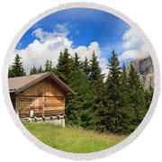 barn on Alpine pasture Round Beach Towel