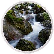 Below Rainier Round Beach Towel by Chad Dutson