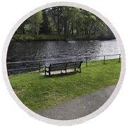 Bench On Shore Of River Ness In Inverness Round Beach Towel